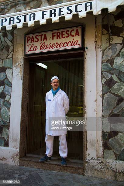 Siracusa, Sicily: Pasta Maker in White Garb Stands Doorway