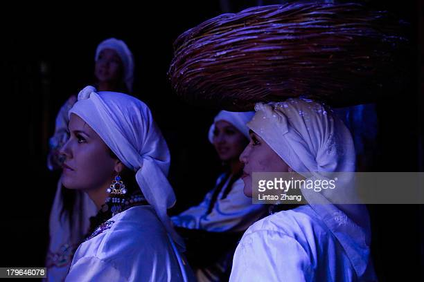 Sirdaryo navolari Ensemble of Uzbekistan rest in the backstage during the 2013 Zhangjiajie International Country Music Week on September 2 2013 in...