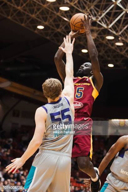 Sir'Dominic Pointer of the Canton Charge shoots over JP Macura of the Greensboro Swarm on December 15 2018 at the Canton Memorial Civic Center in...