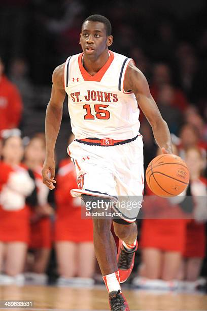 Sir'Dominic Pointer of the St John's Red Storm dribbles up court during a college basketball game against the Marquette Golden Eagles on February 1...