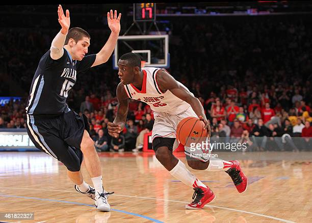 Sir'Dominic Pointer of the St John's Red Storm drives to the basket against Ryan Arcidiacono of the Villanova Wildcats during the game at Madison...