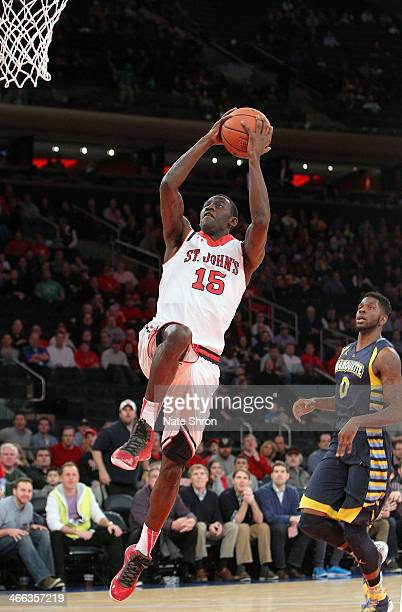 Sir'Dominic Pointer of the St John's Red Storm drives to the basket against Jamil Wilson of the Marquette Golden Eagles during the game at Madison...