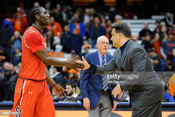 Sir'Dominic Pointer of the St John's Red Storm greets Head coach Steve Lavin following the game against the Syracuse Orange at the Carrier Dome on...