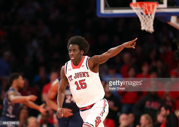 Sir'Dominic Pointer of the St John's Red Storm points as he cheers and runs down the court after a play against the Georgetown Hoyas during the game...