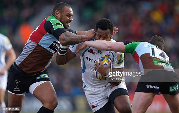 Sireli Naqelevuki of Exeter is tackled by Jordan TurnerHall of Quins during the Aviva Premiership match berween Harlequins and Exeter Chiefs at...