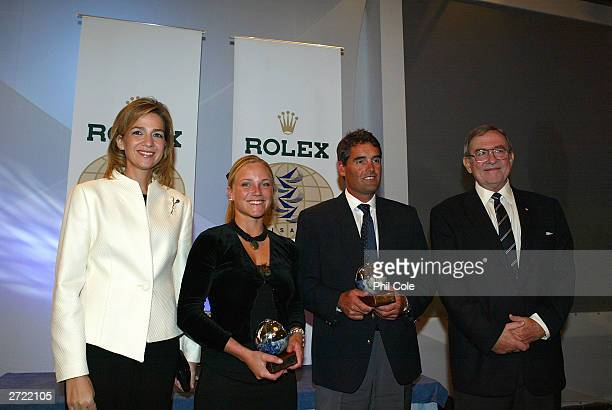 Siren Sundby of Norway and Russell Coutts of Switzerland winners of the ISAF Rolex World Sailor of the year award 2003 receive their trophys from...