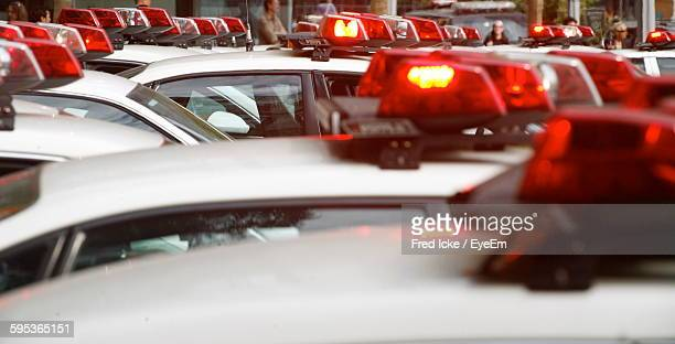 sirens of police cars - police lights stock pictures, royalty-free photos & images