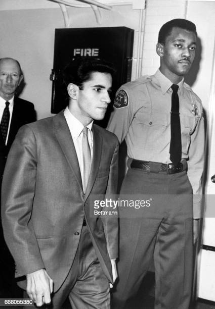 Sirhan Sirhan enters the courtroom accompanied by a deputy sheriff and followed by one of his attorneys Emile Zola Berman