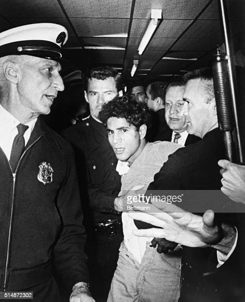 Sirhan Sirhan is led away from the Ambassador Hotel after shooting Robert F Kennedy