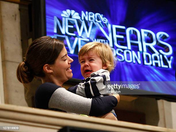 Siri Pinter and Jackson James ring the opening bell at The New York Stock Exchange on December 30 2010 in New York City
