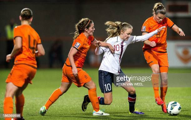 Siri Worm and Sherida Spitse of the Netherlands vie for the ball against Caroline Hansen of Norway during the Fifa World Cup 2015 qualifying football...