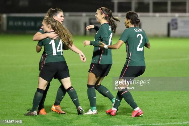 Siri Worm of Tottenham Hotspur celebrates with teammates after scoring her team's first goal during the Barclays FA Women's Super League match...