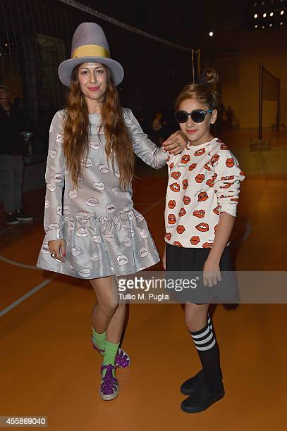 Siria and her daughter Alice attend Au Jour Le Jour show during the Milan Fashion Week Womenswear Spring/Summer 2015 on September 21 2014 in Milan...