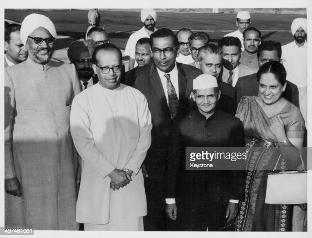 Sirimavo Bandaranaike, Prime Minister of Ceylon, with Indian Prime Minister Lal Bahadur, Trade Minister D B Ilangaratne and Indian Minister Swaran...