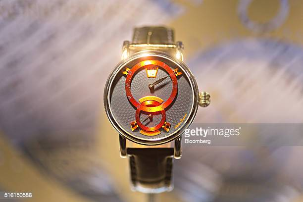 A 'Sirius Flying Regulator' luxury wristwatch produced by Chronoswiss Uhren GmbH sits on display at the company's booth during the 2016 Baselworld...