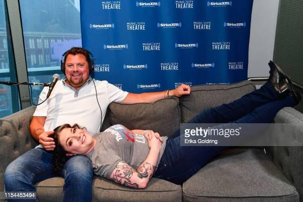 Sirius XM Host Storme Warren and recording artist Ashley McBryde attend SiriusXM Nashville Studios at Bridgestone Arena on June 07 2019 in Nashville...