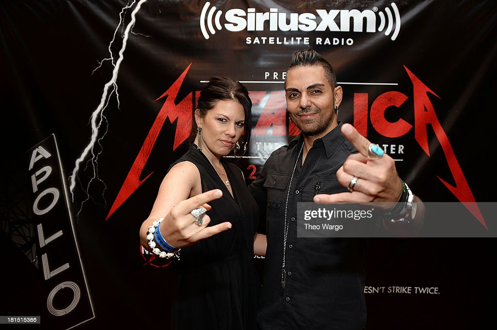 SiriusXM Director of Programming Jose Mangin (R) and SiriusXM host Kayla Riley attend Metallica's private, exclusive concert for SiriusXM listeners at The Apollo Theater on September 21, 2013 in New York City.