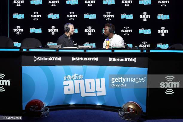 SiriusXM host Andy Cohen and NFL player DK Metcalf of the Seattle Seahawks speak onstage during day 3 of SiriusXM at Super Bowl LIV on January 31...