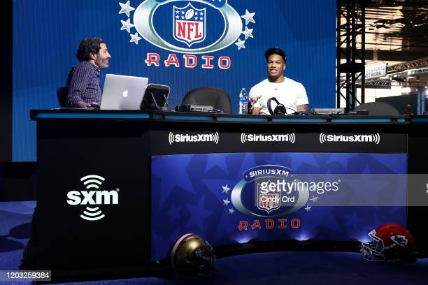 SiriusXM host Bruce Murray and NFL wide receiver DJ Moore of the Carolina Panthers speak onstage during day 3 of SiriusXM at Super Bowl LIV on...