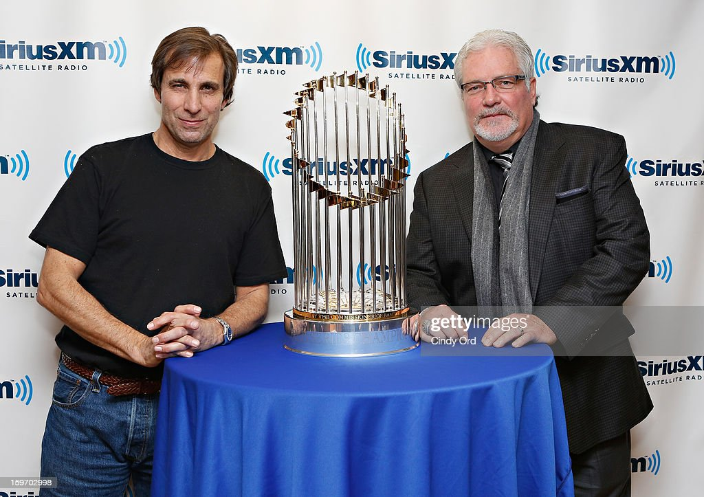 SiriusXM host Chris 'Mad Dog' Russo and San Francisco Giants general manager Brian Sabean pose with the 2012 World Series trophy at the SiriusXM Studios on January 18, 2013 in New York City.