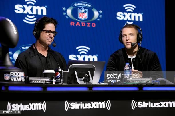 SiriusXM host Ed McCaffrey and NFL running back Christian McCaffrey of the Carolina Panthers speak onstage during day 2 of SiriusXM at Super Bowl LIV...