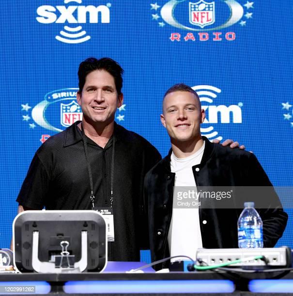 SiriusXM host Ed McCaffrey and NFL running back Christian McCaffrey of the Carolina Panthers take photos during day 2 of SiriusXM at Super Bowl LIV...