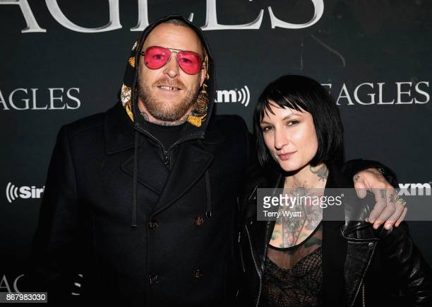 SiriusXM host Jason Ellis and Katie Gilbert attend SiriusXM presents Eagles in their first ever concert at the Grand Ole Opry House on October 29...