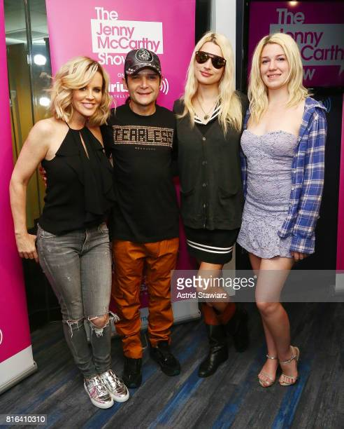 SiriusXM host Jenny McCarthy actor/musician Corey Feldman Courtney Feldman and Jackie von Rueden pose for photos during 'The Jenny McCarthy Show' at...