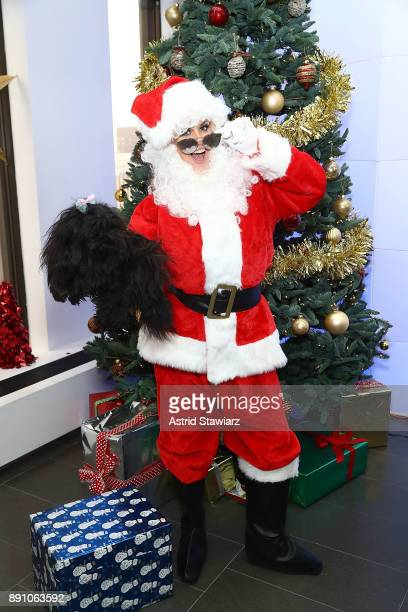 SiriusXM host Jenny McCarthy poses for photos in a Santa costume with her dog DJ at the SiriusXM studios on December 12 2017 in New York City Ê