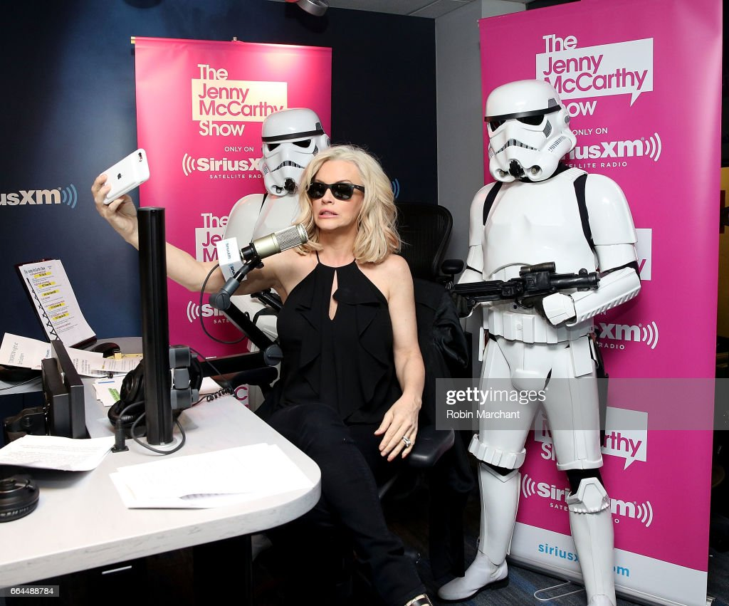 SiriusXM host Jenny McCarthy (C) poses with Stormtroopers for Blu-Ray release of Rouge One during 'The Jenny McCarthy Show' at SiriusXM Studios on April 4, 2017 in New York City.