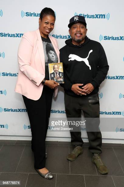 SiriusXM host Karen Hunter poses for photos with entrepreneur and author Daymond John during SiriusXMÕs Town Hall series at SiriusXM Studios on April...