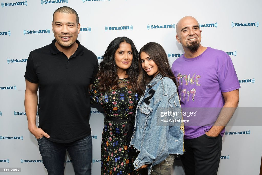 SiriusXM host Michael Yo, actress Salma Hayek, and SiriusXM hosts Symon and Tony Fly pose for a photo as Salma Hayek visits the SiriusXM Studios on August 17, 2017 in Los Angeles, California.