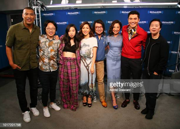 SiriusXM host Michael Yo poses with Jimmy O Yang Awkwafina Constance Wu Kevin Kwan Michelle Yeoh Henry Golding and Ken Jeong during SiriusXM's...
