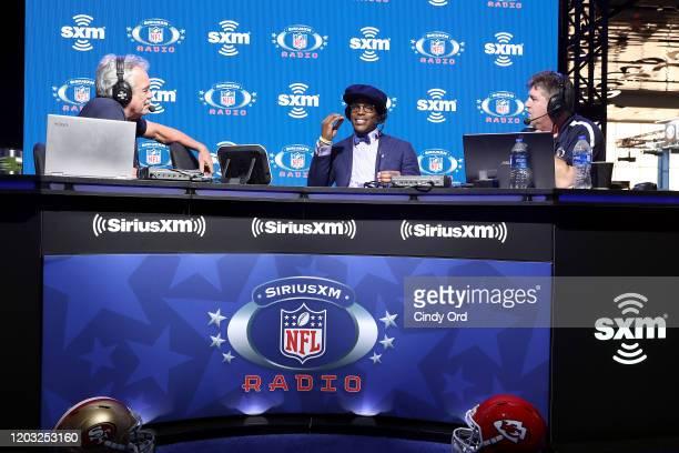 SiriusXM host Pat Kirwan NFL quarterback Cam Newton of the Carolina Panthers and SiriusXM host Jim Miller speak onstage during day 3 of SiriusXM at...