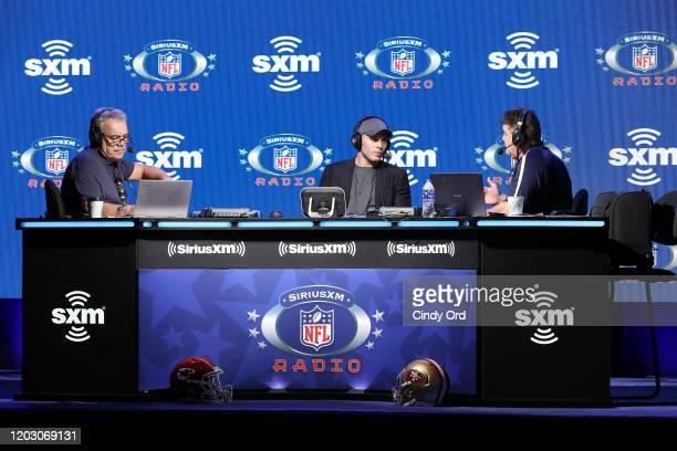 SiriusXM host Pat Kirwan NFL safety Harrison Smith of the Minnesota Vikings and SiriusXM host Jim Miller speak onstage during day 2 of SiriusXM at...