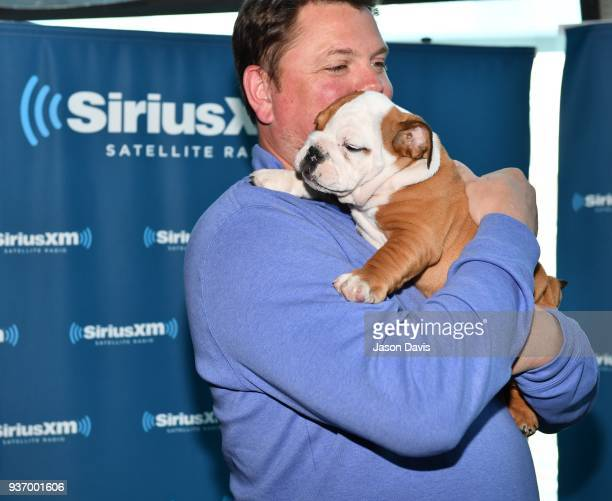 SiriusXM Host Storme Warren and Recording Artist Ryan Hurd's dog Pancake arrive at SiriusXM Studios on March 21 2018 in Nashville Tennessee