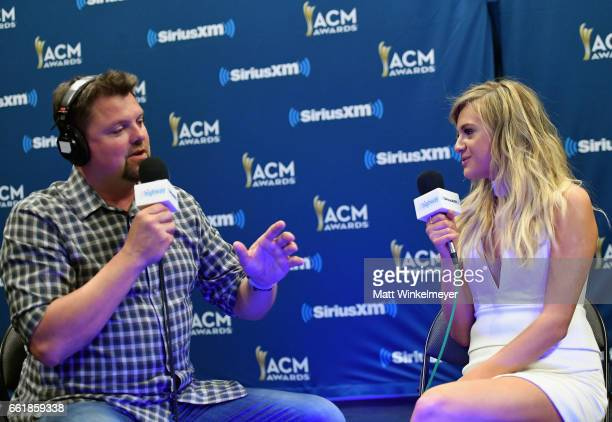 SiriusXM host Storme Warren and singer Kelsea Ballerini speak during SiriusXM's The Highway Channel broadcasts leading up to the ACM Awards at...
