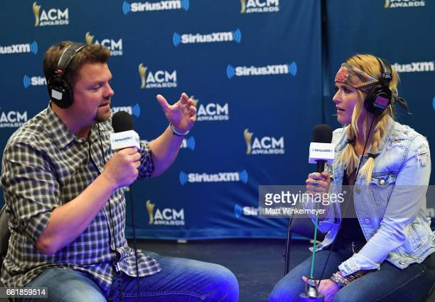 SiriusXM host Storme Warren and singer Miranda Lambert speak during SiriusXM's The Highway Channel broadcasts leading up to the ACM Awards at TMobile...