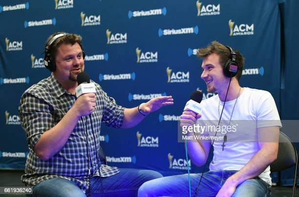 SiriusXM host Storme Warren and singer Morgan Wallen speak during SiriusXM's The Highway Channel broadcasts leading up to the ACM Awards at TMobile...