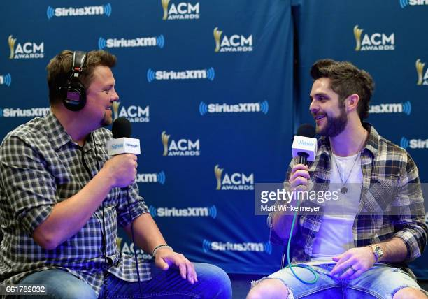 SiriusXM host Storme Warren and singersongwriter Thomas Rhett attend SiriusXM's The Highway Channel broadcasts backstage leading up to the American...