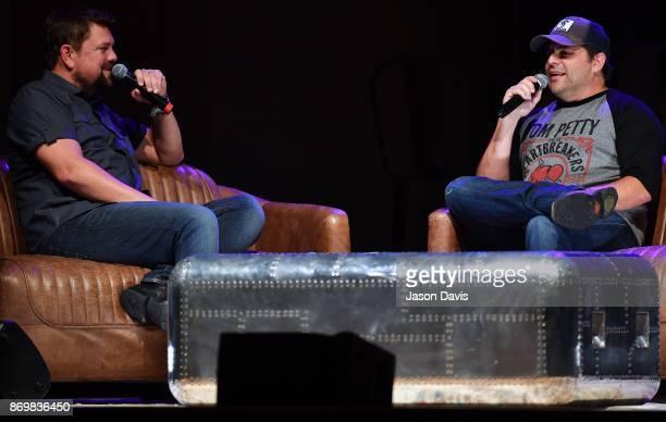 SiriusXM Host Storme Warren speaks with Recording Artist Rhett Akins on stage during Nashville House Concerts at War Memorial Auditorium on November...