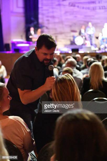 SiriusXM Host Storme Warren speaks with the crowd for song ideas during Nashville House Concerts at War Memorial Auditorium on November 2 2017 in...