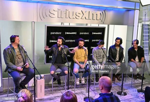 SiriusXM host Storme Warren talks with musicians Matthew Ramsey Brad Tursi Whit Sellers Geoff Sprung and Trevor Rosen of Old Dominion during...