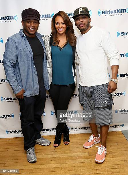 SiriusXM host Sway poses with TV personality Evelyn Lozada and rapper Nelly at SiriusXM Studios on September 24 2013 in New York City