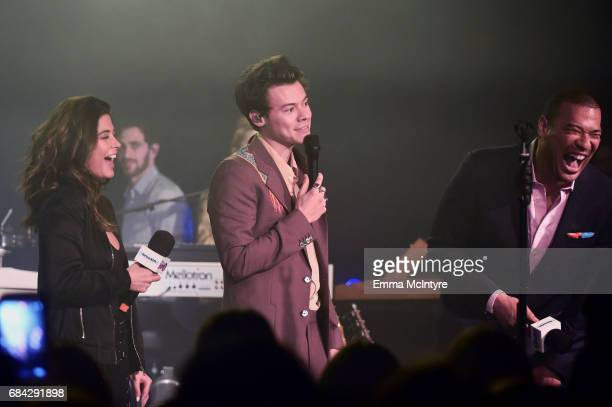 """SiriusXM host Symon musician Harry Styles and SiriusXM host Michael Yo answer questions during a SiriusXM Hits 1 special hosted by SiriusXM's """"Hits 1..."""