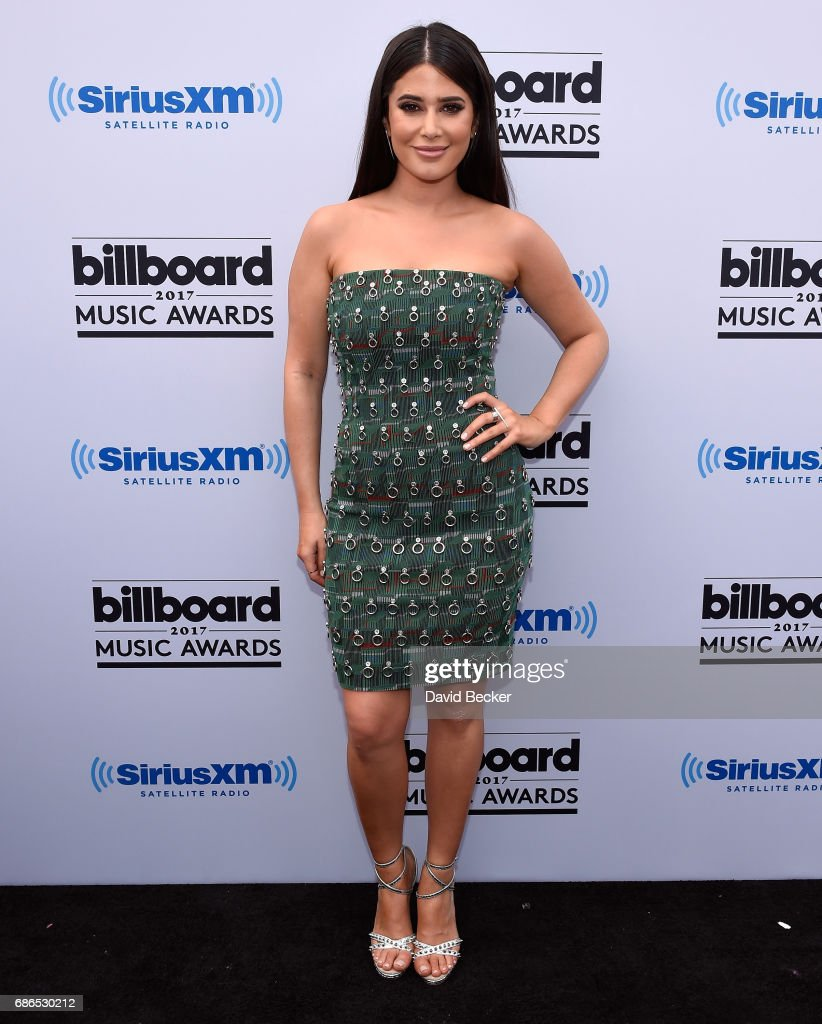 SiriusXM host SymonÊposes at SiriusXM's 'Hits 1 in Hollywood' red carpet broadcast on SiriusXM's SiriusXM Hits 1 channel before the Billboard Music Awards at the T-Mobile Arena on May 21, 2017 in Las Vegas, Nevada.
