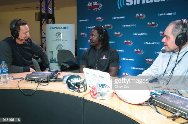 SiriusXM hosts Danny Kanell and Steve Torre and Melvin Ingram of the Los Angeles Chargers attend SiriusXM at Super Bowl LII Radio Row at the Mall of...