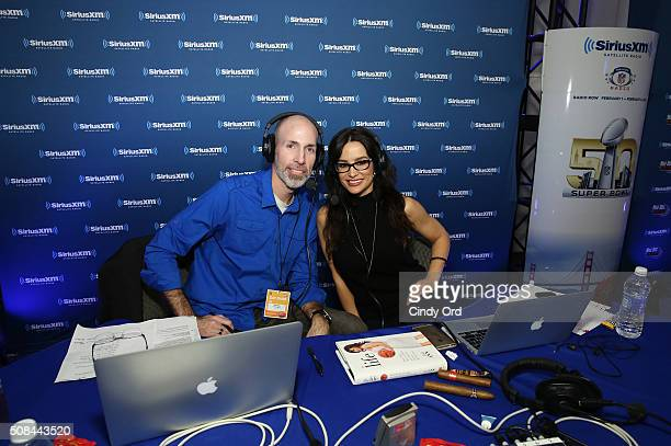SiriusXM hosts Lisa Ann and Ray Flowers host at the SiriusXM set at Super Bowl 50 Radio Row at the Moscone Center on February 4 2016 in San Francisco...