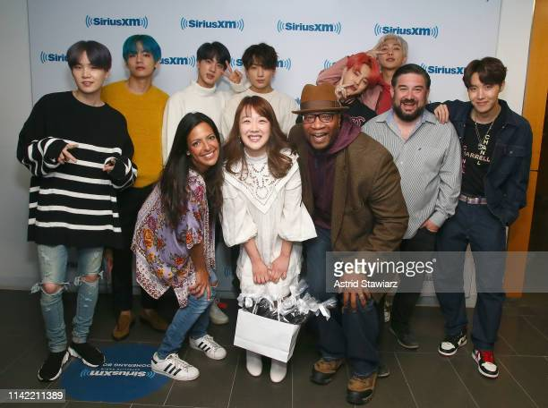 SiriusXM hosts Nicole Ryan Min Suh Stanley T and Ryan Sampson pose with South Korean group BTS while visiting 'The Morning Mash Up' On SiriusXM Hits...