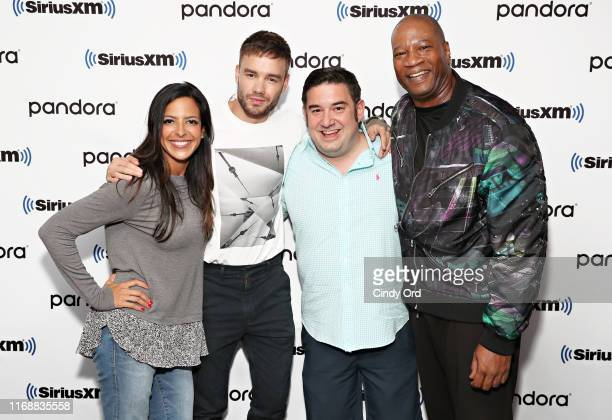SiriusXM hosts Nicole Ryan Ryan Sampson and Stanley T pose for a photo with Liam Payne during SiriusXM Celebrity Session with Liam Payne on Hits1 at...